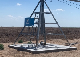 part of sprinkler system out in dirt field