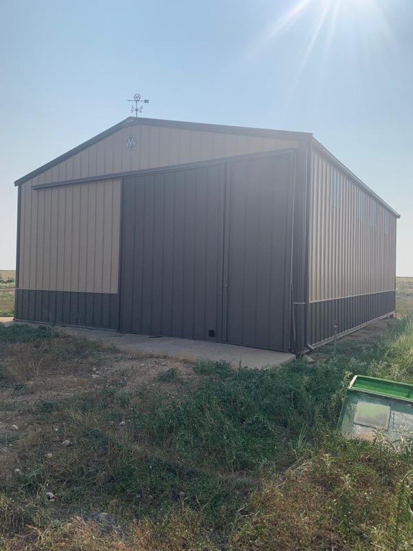 tan barn with brown doors
