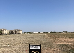 3 acres of land with gillispie land group sign in the front