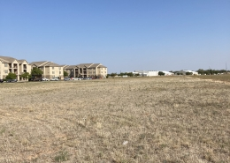 commercial lot land with apartment buildings in the background