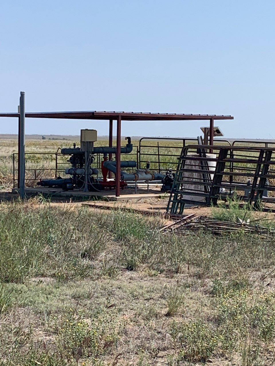 Steel barn equipment and gates in a field