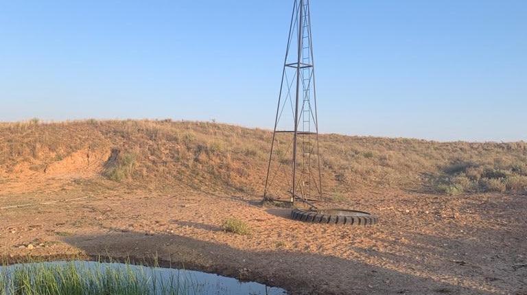 windmill next to pond
