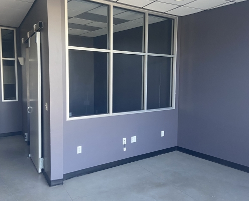 office space with light purple walls