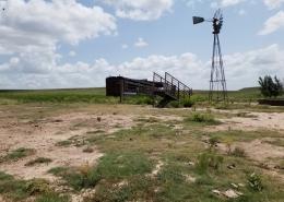 windmill in farm land grass