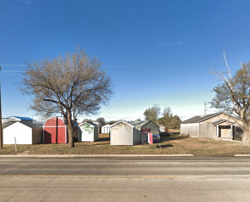 picture of lot with small whit storage units on it