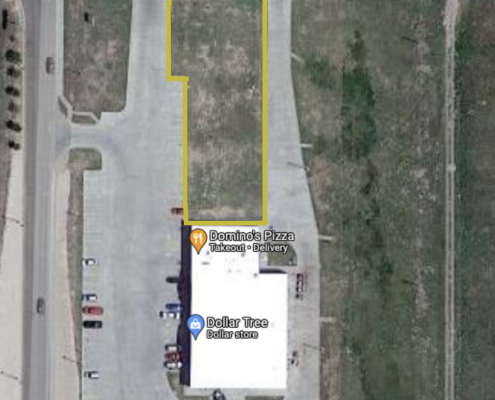 google satellite image of aerial view of walmart with a logo on the building and yellow outlined piece of land to the north of walmart